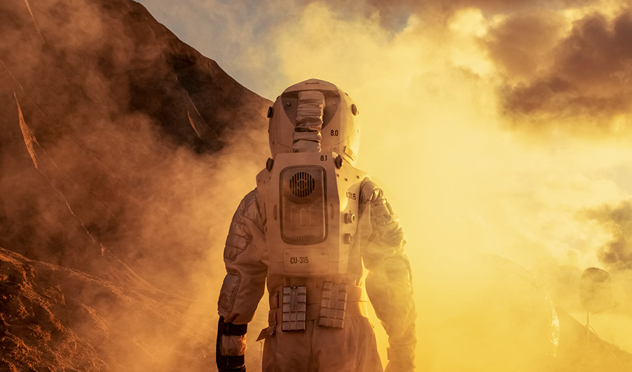 A conceptual photo of an astronaut on an alien planet.