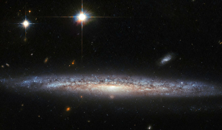 A spiral galaxy located 130 million light-years away