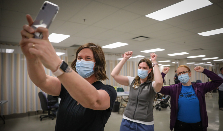 Alberta nurses take a selfie after receiving COVID-19 vaccine