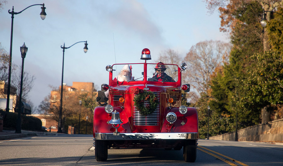 Santa in Marietta, Georgia, riding in a firetruck
