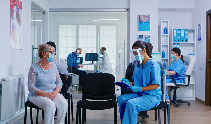 Medical office setting, with staff and patients in masks