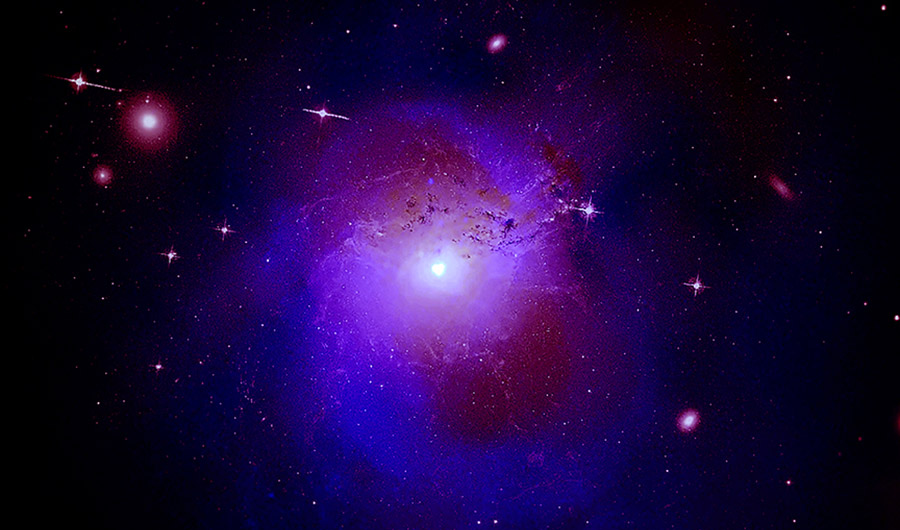 The Perseus cluster is pictured here as a bright purple cloud with a shining center.