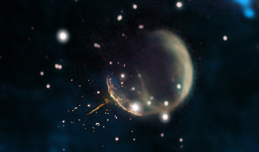 The remnants of a supernova shell are seen here are a giant, gaseous bubble. From it zooms a pulsar, leaving an orange trail in its wake. The picture is dotted with blurry stars.