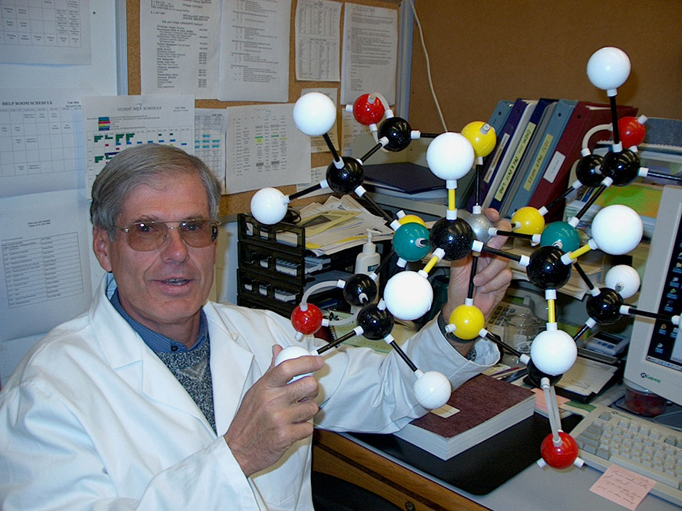 The author's father, Robert Meyers, hold a large molecular model