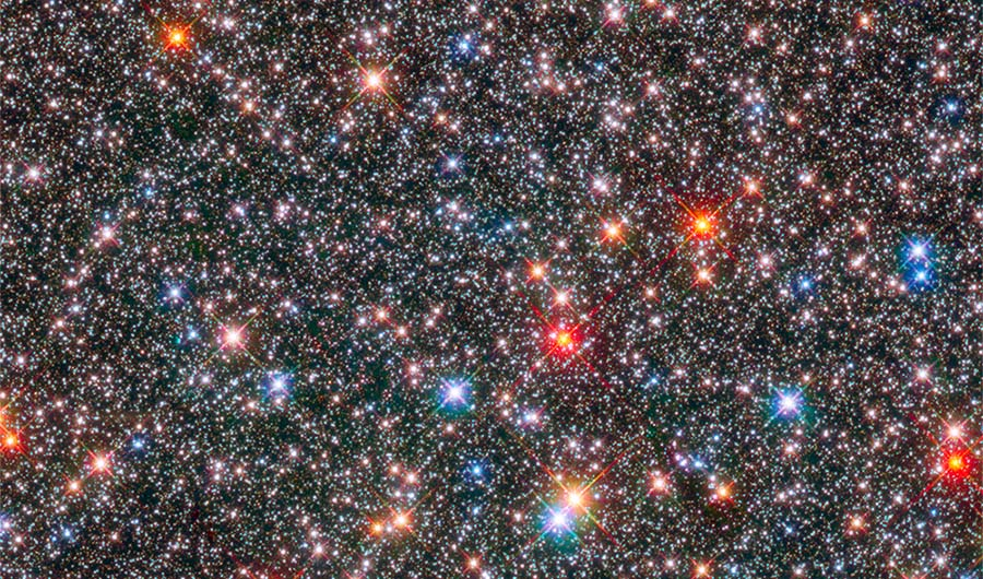 An image of the Milky Way bulge, in which countless different stars glitter.