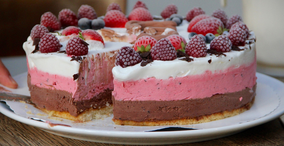 Ice cream cake covered with berries