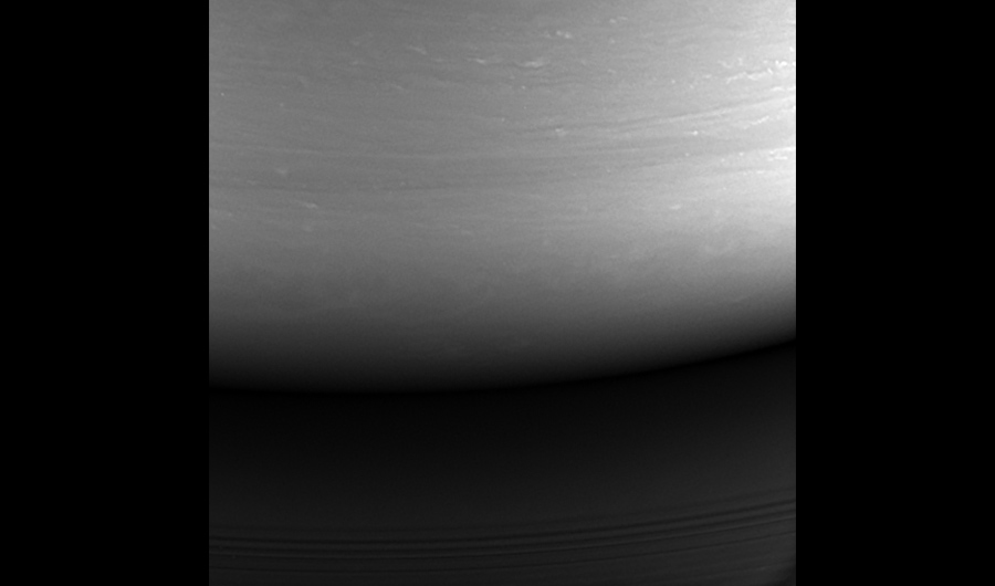 Cassini's final image, taken by the spacecraft as it looks towards Saturn's night side.