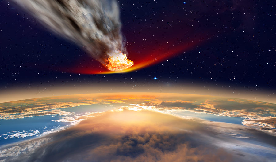 image shows asteroid entering atmosphere above Earth, surrounded by smoke and fire