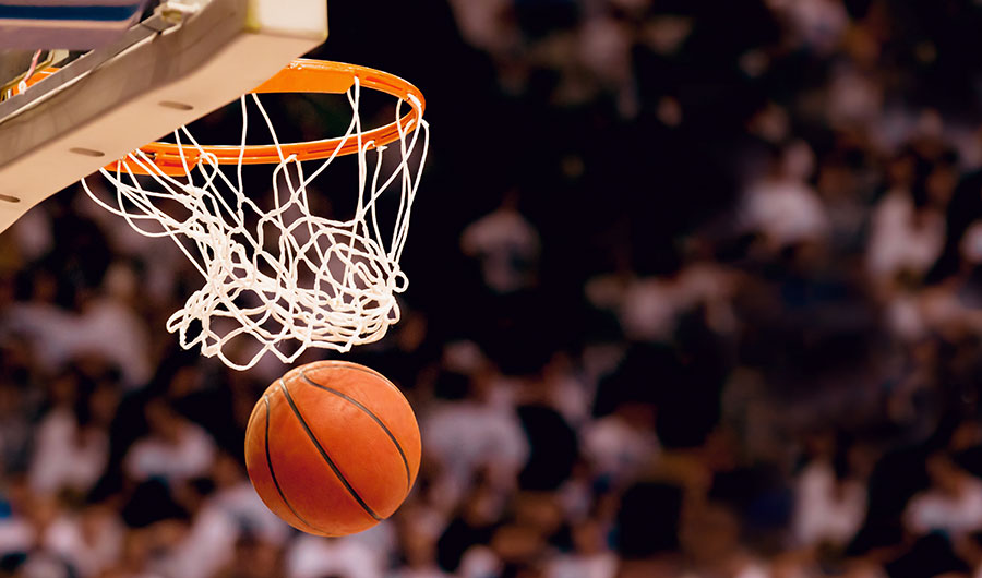 Image shows a basketball dropping through a hoop
