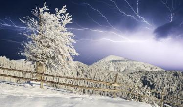 Lightning over a snowy landscape