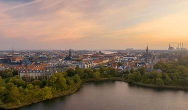 Morning light over the city skyline of Copenhagen with a power plant in the background.