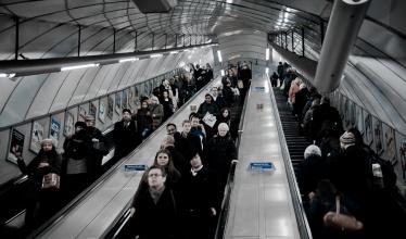 Photo of people on an escalator