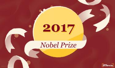 A gold medal sits atop a burgundy background, surrounded by waving ribbons. The ribbon atop the medal says Nobel Prize.
