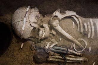 Fifth millennium B.C. skeleton and burial gifts.